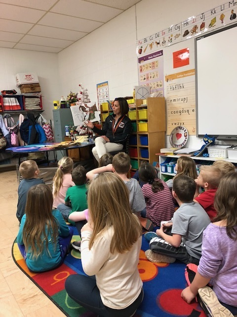 Mrs. Augspurg reading to first graders