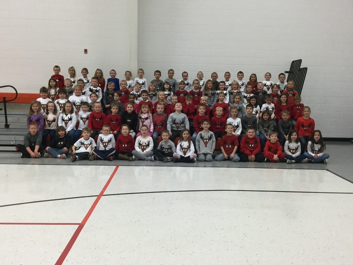 All first graders wearing their reindeer shirts!