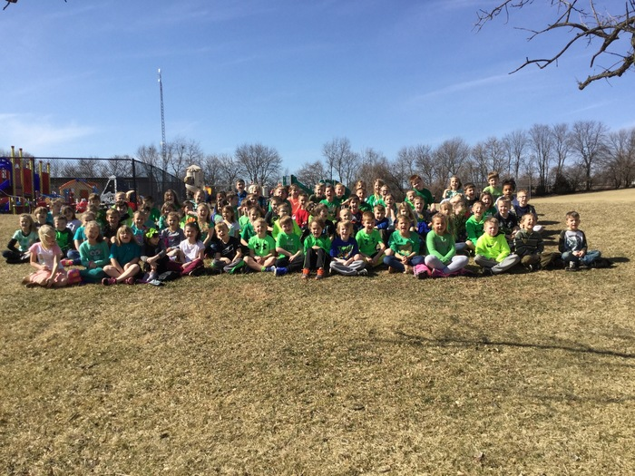 First graders wearing green